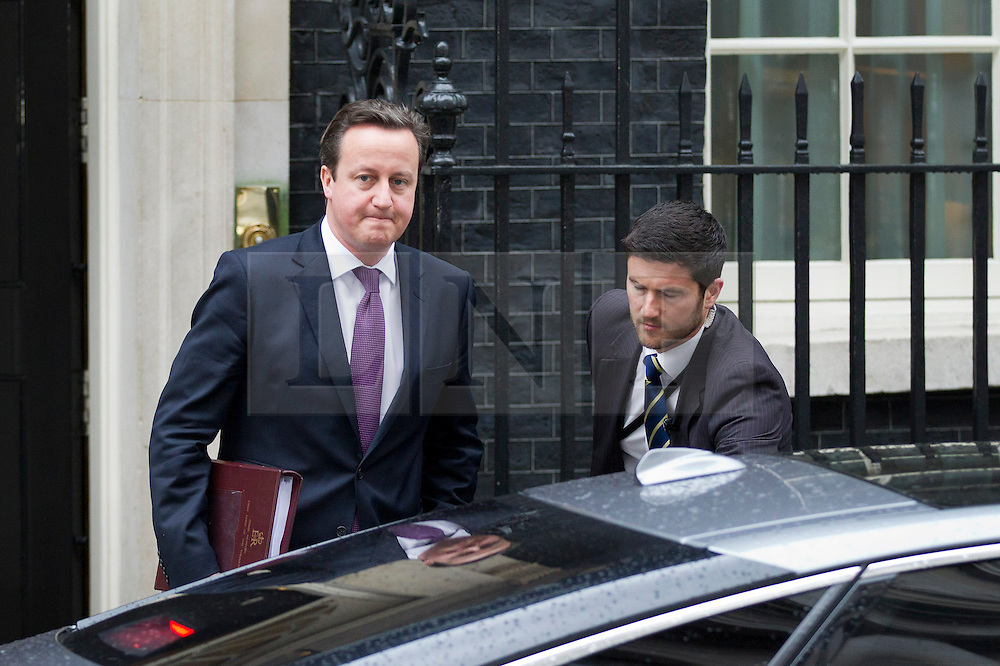 "© Licensed to London News Pictures. 30/01/2013. London, UK. The British Prime Minister, David Cameron, is seen leaving Number 10 Downing Street in London today (30/01/13) for Prime Ministers Questions.  The Prime minister is expected to leave for Algeria this afternoon, the first visit to the country by a British Prime Minister since since its independence from France 51 years ago (1962), where he will discuss ""the generational struggle"" against al-Qaeda in North Africa and the recent hostage crisis at the country's Amenas gas plant earlier this month. Photo credit: Matt Cetti-Roberts/LNP"