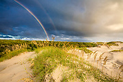 Outer Bank sand dunes and double rainbow in Corolla North Carolina.