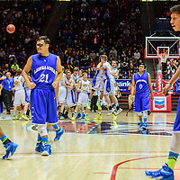 031415  Adron Gardner/Independent<br /> <br /> Laguna Acoma Hawk Ryan Arkie (31), left, Matt Sanchez (21), Austyn Salvador (0) and Kameron Joe (23) walk off the court as the Mesilla Valley Christian SonBlazers celebrate during a 3A New Mexico state basketball tournament final at The Pit in Albuquerque Saturday. The SonBlazers beat the Hawks for the 3A title 63-49.
