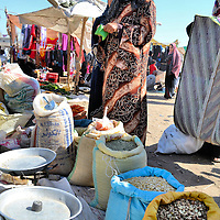 Woman Shop for Grain at Market Wearing Abaya and Head Scarf in Luxor, Egypt<br />