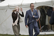 Kevin McCloud and his wife Zani, Cartier Style et Luxe champagne reception and lunch at the  the Goodwood festival of Speed. 9 July 2006. -DO NOT ARCHIVE-© Copyright Photograph by Dafydd Jones 66 Stockwell Park Rd. London SW9 0DA Tel 020 7733 0108 www.dafjones.com