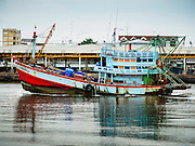 13 MAY 2015 - MAHACHAI, SAMUT SAKHON, THAILAND: A fishing boat comes into the port of Mahachai, Samut Sakhon province. Mahachai is one of Thailand's most important fishing ports.   PHOTO BY JACK KURTZ