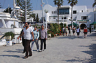 Scenes from Tunisia's resort area, El Kantouai, tourist by yacht and restaurants