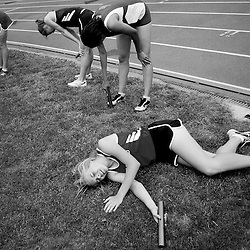 Kyle Green | The Roanoke Times<br /> May 27, 2006 Jackie Zillioux, from Cave Spring High School collapses in exhaustion after running the anchor lap on the girls 4x400 relay during the Region III Championships held at Liberty College in Lynchburg on Saturday afternoon. Cave Spring finised third in the 4x400. The William Fleming girls track team won the overall team competition at the meet.