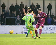 Annan keeper Jordan Hart kicks the ball against team-mate Martin McNiff with the ball rebounding into the defender's own goal - Arbroath v Annan Athletic, Ladbrokes SPFL League two at Gayfield<br /> <br />  - &copy; David Young - www.davidyoungphoto.co.uk - email: davidyoungphoto@gmail.com