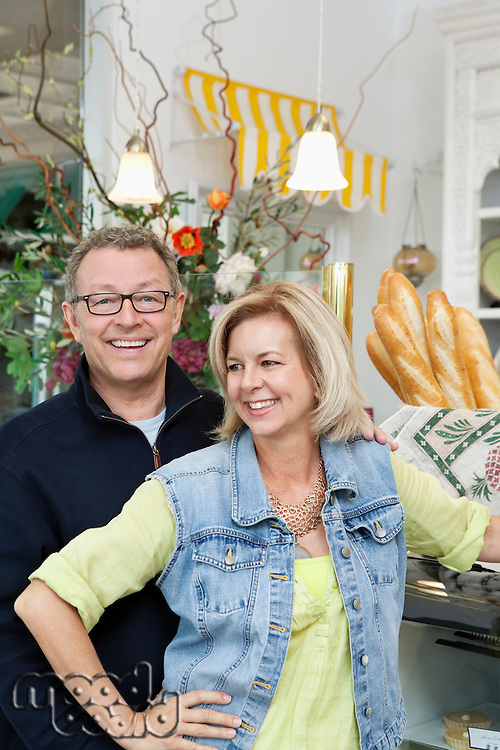 Happy mature couple in cake shop