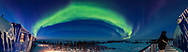 A 180&deg; panorama of the auroral oval across the northern horizon in the twilight sky on February 18, 2018. The aurora was active right at the start of the evening this night, the final night of my stay in Churchill for 2018, here at the Northern Studies Centre. <br /> <br /> The panorama is from the upper floor deck. The aurora appeared so early we had not had a chance yet to turn off the building lights &ndash; programs were still happening inside. <br /> <br /> The temperature was -35&deg; C. Up from low of -40 earlier in the day. The wind had also died down, mercifully! <br /> <br /> Orion is rising at right. <br /> <br /> This is a 9-segment panorama stitched with Adobe Camera Raw. The lens is the 14mm Sigma Art lens wide open at f/1.8 and Nikon D750 at ISO 3200. Exposures were 4 seconds each. For the last one, with the self-timer I got into the last frame for a selfie.