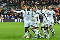 Football - 2019 / 2020 Sky Bet (EFL) Championship - Swansea City vs. Wigan Athletic<br /> <br /> André Ayew of Swansea City celebrates scoring his team's second goal, at the Liberty Stadium.<br /> <br /> COLORSPORT/WINSTON BYNORTH