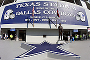 IRVING, TX - JANUARY 13: The team star logo and statue of former coach Tom Landry of the Dallas Cowboys adorn the front of Texas Stadium prior to the New York Giants NFC Divisional Playoff Game against the Dallas Cowboys at Texas Stadium on January 13, 2008 in Irving, Texas. ©Paul Anthony Spinelli