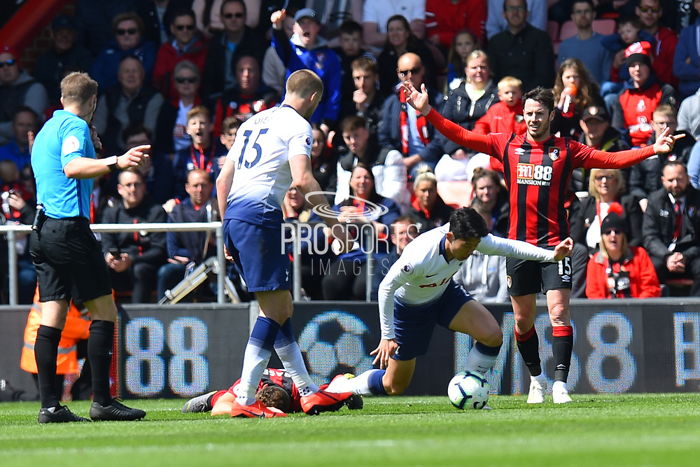 Son Heung-Min (7) of Tottenham Hotspur goes down as h tangles with Ryan Fraser (24) of AFC Bournemouth and then gets sent off for a punch on Jefferson Lerma (8) of AFC Bournemouth during the Premier League match between Bournemouth and Tottenham Hotspur at the Vitality Stadium, Bournemouth, England on 4 May 2019.