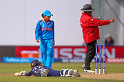 England womens cricket Fran Wilson is stranded and a review confirms her run out during the ICC Women's World Cup match between England and India at the 3aaa County Ground, Derby, United Kingdom on 24 June 2017. Photo by Simon Davies.