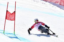 KANO Akira LW11 JPN competing in ParaSkiAlpin, Para Alpine Skiing, Super G at PyeongChang2018 Winter Paralympic Games, South Korea.