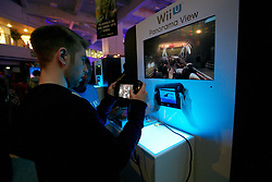 © Licensed to London News Pictures.  27/09/2012. LONDON, UK. Visitors try out the unreleased Wii U console at the Eurogamer Expo in Earls Court London. The show opened today (Thursday) and 50,000 people are expected to attend over the next 4 days. Photo credit :  Cliff Hide/LNP