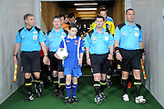 Referee's and Ball boy come out before match,  A-League football pre season match - Wellington Phoenix v Brisbane Roar at Forsyth Barr Stadium, Dunedin, New Zealand on Saturday, 20 August 2011. Photo: Richard Hood/photosport.co.nz