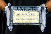 Wonka's Golden Ticket - A collection of contemporary movie props, memorabilia and costumes to be auctioned on 16 October. It will include 375 items collected over 10 years and potentially worth more than £1 million. Highlights include:  Back to the Future: Part II -  Marty McFly's (Michael J. Fox) Mattel Hoverboard (estimated at £14,000 - £18,000); Willy Wonka and the Chocolate Factory - Wonka's (Gene Wilder) Golden Ticket (£15,000 - £20,000); Batman Forever – Remote control Batmobile model miniature (£20,000 - £30,000); Rush - 'Niki Lauda's (Daniel Brϋhl) Prop Ferrari 312T2 Formula One Car (£20,000 - £30,000); memorabiliaStar Wars: Return of the Jedi - Biker Scout helmet (£8,000-£10,000); and The Shining - Jack and Wendy's (Jack Nicholson & Shelly Duvall) Overlook Hotel Bed (£4,000-£6,000).