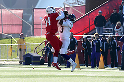 05 December 2015:  in mid air, DraShane Glass(14) and Stacey Smith Jr.(13) struggle for a pass reception. NCAA FCS Round 2 Football Playoff game between Western Illinois Leathernecks and Illinois State Redbirds at Hancock Stadium in Normal IL (Photo by Alan Look)