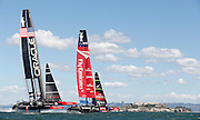 Emirates Team New Zealand (right) pulls ahead of Oracle Team USA on the first windward leg of Race 19 of the America's Cup Finals on Wednesday, September 25, 2013 in San Francisco, Calif.