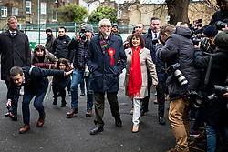 © Licensed to London News Pictures. 12/12/2019. London, UK. Labour Party Leader Jeremy Corbyn and his wife Laura Alvarez arrive at Pakeman Primary School in North London to vote in the 2019 General Election. Photo credit: Rob Pinney/LNP