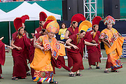 The annual Lotus Lantern Festival is held to celebrate Buddha's Birthday. Opening ceremony for the parade at Dongdaemun Stadium. Lamaist monks dancing joyfully.