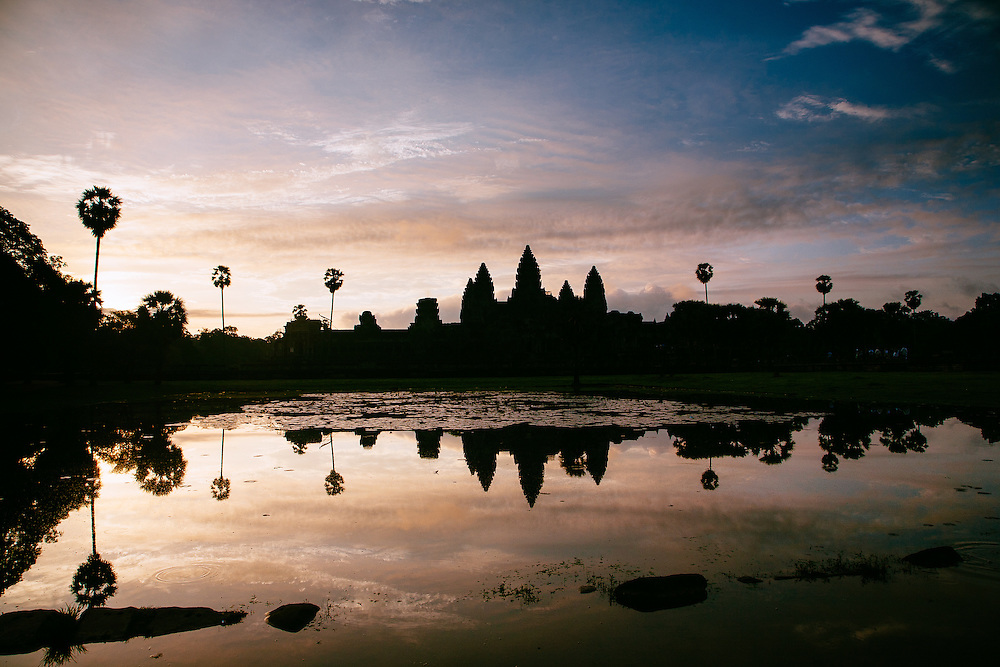 Angkor Wat temple reflected during sunrise across one of the man made ponds in the grounds of the temple.