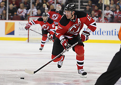 Oct 21; Newark, NJ, USA; New Jersey Devils left wing Ilya Kovalchuk (17) skates with the puck during the second period at the Prudential Center.