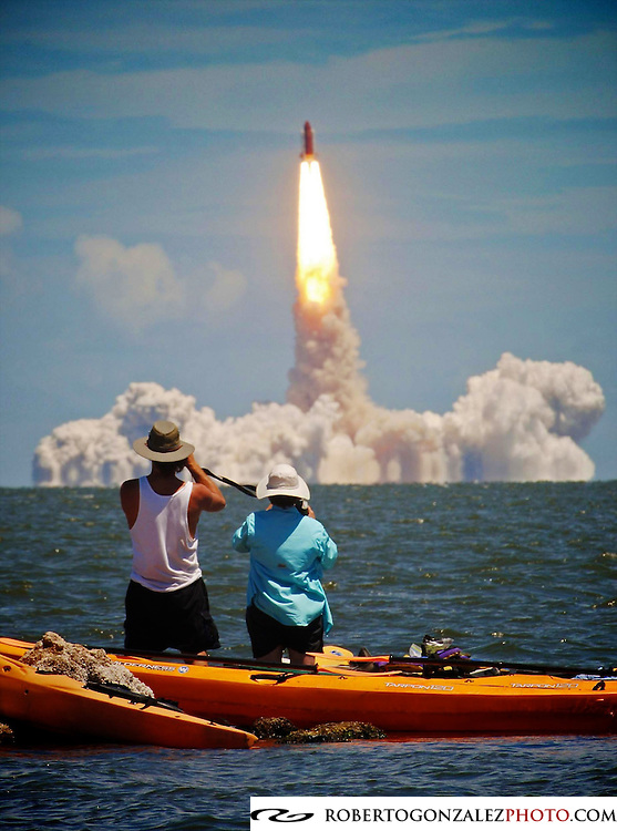 """Eco-tourists find a low tech way away from the crowds in order to watch the liftoff of Space Shuttle Discovery from Cape Canaveral""    Low Tech Finds High Tech"