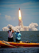 """""""Eco-tourists find a low tech way away from the crowds in order to watch the liftoff of Space Shuttle Discovery from Cape Canaveral""""    Low Tech Finds High Tech"""