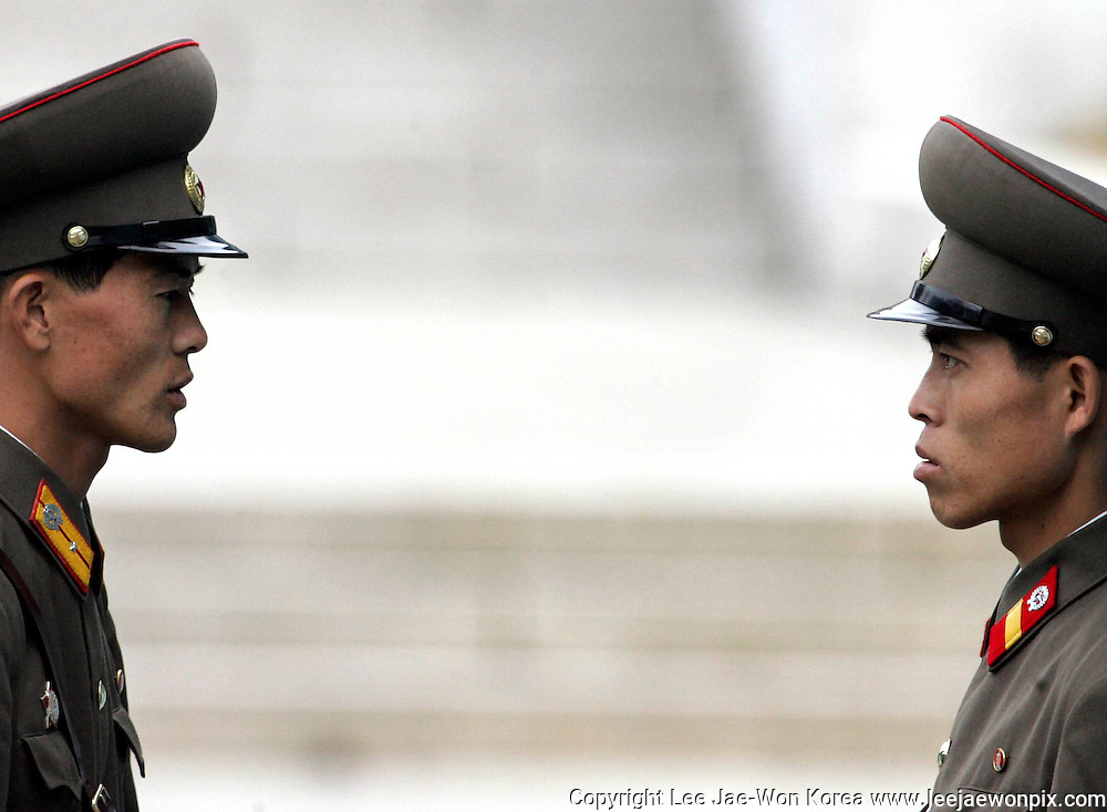 North Korean soldiers stand guard at the truce village of Panmunjom in the demilitarized zone which separates the two Koreas, about 55 km (34 miles) north of Seoul, November 1, 2006. Photo by Lee Jae-Won (KOREA) www.leejaewonpix.com