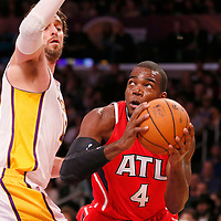 03 November 2013: Atlanta Hawks power forward Paul Millsap (4) drives past Los Angeles Lakers power forward Pau Gasol (16) during the Los Angeles Lakers 105-103 victory over the Atlanta Hawks at the Staples Center, Los Angeles, California, USA.