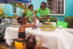 "Nyimah Jacobs and Nevawn Samuel are delighted with their cupcakes given to them by Shanell Thomas and Kayla Anthony of Kenisha's Island Delights. The Festival & Cultural Organization of St. John Presents It's Annual Food Fair honoring Delroy ""Ital"" Anthony and Royal Coronation 2016.  Franklin A. Powell, Sr. Park.  St. John, US Virgin Islands.  26 June 2016.  © Aisha-Zakiya Boyd"