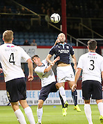 Dundee's Gary Harkins out jumps Raith Rovers' Grant Anderson - Dundee v Raith Rovers, Scottish League Cup at Dens Park<br /> <br />  - &copy; David Young - www.davidyoungphoto.co.uk - email: davidyoungphoto@gmail.com
