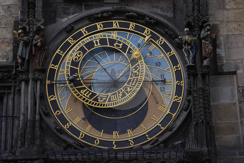 Famous astronomical clock at the Prague Town Hall and Tower in Prague, Czech Republic. The clock was first built in the 15th century and the clockmaker blinded to prevent him from creating another.