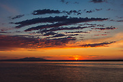 "Fiery sunset Kink Arm with Mount Susitna. Often referred to as Sleeping Lady because it looks like a woman laying down and many of us have gone our whole life thinking that was the native lore and that Susitna means sleeping lady. The mountain's Dena'ina name is Dghelishla, meaning ""Little Mountain""; in English it was simply named for the Susitna River which means Sandy River."