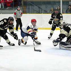 WELLINGTON, ON - JANUARY 18: Jacob Thousand #23 of the Wellington Dukes tries to keep the puck from Samuel Duchesne #19 of the Trenton Golden Hawks on January 18, 2019 at Wellington and District Community Centre in Wellington, Ontario, Canada.<br /> (Photo by Ed McPherson / OJHL Images)