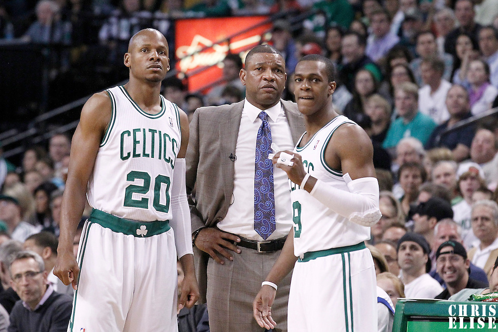 12 May 2012: Boston Celtics head coach Doc Rivers talks to Boston Celtics shooting guard Ray Allen (20) and Boston Celtics point guard Rajon Rondo (9) during the Boston Celtics 92-91 victory over the Philadelphia Sixers, in Game 1 of the Eastern Conference semifinals playoff series, at the TD Banknorth Garden, Boston, Massachusetts, USA.