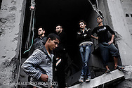 Gaza City: Palestinians observe rescue operations in a house, after was bombed by Israeli Air Force. November 17, 2012. ALESSIO ROMENZI