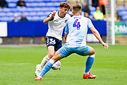 Bolton Wanderers midfielder Callum King-Harmes tackled by Coventry City defender Michael Rose during the EFL Sky Bet League 1 match between Bolton Wanderers and Coventry City at the University of  Bolton Stadium, Bolton, England on 10 August 2019.