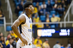 Nov 20, 2015; Morgantown, WV, USA; West Virginia Mountaineers forward Devin Williams looks on during a foul shot during the first half against the Stetson Hatters at WVU Coliseum. Mandatory Credit: Ben Queen-USA TODAY Sports
