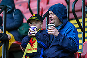 Two fans enjoy hot drinks ahead of the Premier League match between Watford and Bournemouth at Vicarage Road, Watford, England on 26 October 2019.