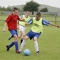 Christopher Dickson of Moneypoint F.C and Peter Bannon of Newtown F.C. go head to head in Shannon on Friday as trials for the U-15 and16 Irish soccer squad took place.<br /> <br /> Photograph by Yvonne Vaughan.