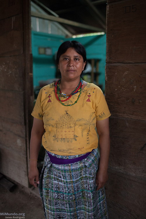 Clara Chen Osorio, 40, survivor from Rio Negro, stands in her porch. She hopes the Forensic Anthropology Foundation of Guatemala (FAFG) identifies and returns both her grandfather Jose Osorio Valey (80) and grandmother Gregoria Chen (70), who were abducted and placed in a helicopter during the May 14, 1982, Los Encuentros Massacre and possibly exhumed in 2012 from grave XV at the UN's CREOMPAZ training center, formerly Coban's Military Zone 21. During the massacre, Guatemalan soldiers and civil patrolmen killed 79 community members from Rio Negro who were hiding here after the previous two massacres of February and March of the same year. Eyewitnesses assured that at least 15 other community members were abducted in a helicopter. As of May 2016, CREOMPAZ's grave XV has rendered positive DNA matches of the remains of two victims abducted in the helicopter on such day. Clara lives in Pacux, the resettlement village outside Rabinal where the former Achi Mayan residents of Rio Negro were forcibly relocated after the massacres and destruction of their village and dozens more due to the flooding of the Chixoy river basin and construction of the Chixoy Hydro-electric project. Pacux, Rabinal, Baja Verapaz, Guatemala. May 20, 2016.