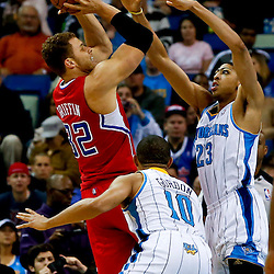 Mar 27, 2013; New Orleans, LA, USA; Los Angeles Clippers power forward Blake Griffin (32) shoots over New Orleans Hornets power forward Anthony Davis (23) and shooting guard Eric Gordon (10) during the first quarter of a game at the New Orleans Arena. Mandatory Credit: Derick E. Hingle-USA TODAY Sports