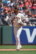 San Francisco Giants shortstop Brandon Crawford (35) runs off the field after making an out against the San Diego Padres at AT&T Park in San Francisco, Calif., on September 14, 2016. (Stan Olszewski/Special to S.F. Examiner)