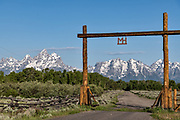 Mount Moran and the Grand Teton mountains at the entrance gate to the Moose Head Ranch at the Grand Teton National Park in Moran, Wyoming.