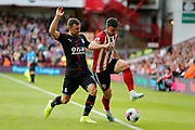 Enda Stevens of Sheffield United dribbles the ball out during the Premier League match between Sheffield United and Crystal Palace at Bramall Lane, Sheffield, England on 18 August 2019.