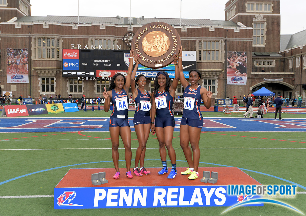 Apr 27, 2018; Philadelphia, PA, USA; Members of the Auburn women's 4 x 100m relay pose with pinwheel after winning the Championship of America in 44.12  during the 124th Penn Relays at Franklin Field. From left: Natalliah Whyte, Dominique Bullock, Jonielle Smith and Renee Shaw.