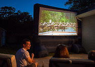 "Merrick, New York, USA. 11th June 2017.  ""American Grit"" TV show contestant CHRIS EDOM (bottom left), 48, of Merrick, hosts Viewing Party for Season 2 premiere.  Edom family's friends and neighbors watched Episode 1 of the Fox network TV show on large screen in their backyard. Edom was the last contestant picked for a team."