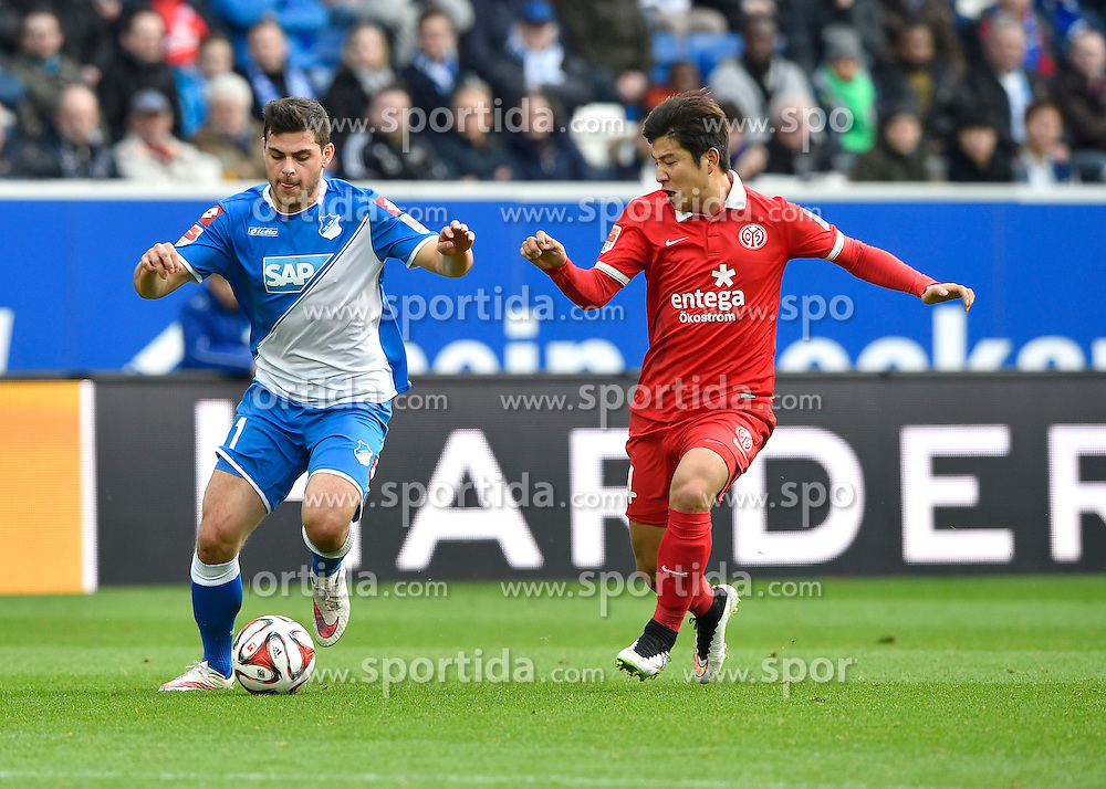 28.02.2015, Rhein Neckar Arena, Sinsheim, GER, 1. FBL, TSG 1899 Hoffenheim vs 1. FSV Mainz 05, 23. Runde, im Bild Zweikampf Aktion Kevin Volland TSG 1899 Hoffenheim (links) gegen Joo-Hoo Park 1. FSV Mainz 05 (rechts) // during the German Bundesliga 23rd round match between TSG 1899 Hoffenheim and 1. FSV Mainz 05 at the Rhein Neckar Arena in Sinsheim, Germany on 2015/02/28. EXPA Pictures &copy; 2015, PhotoCredit: EXPA/ Eibner-Pressefoto/ Weber<br /> <br /> *****ATTENTION - OUT of GER*****
