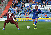 Joseph Mills looks for the cross to open up the defence during the Sky Bet League 1 match between Oldham Athletic and Bradford City at Boundary Park, Oldham, England on 5 September 2015. Photo by Mark Pollitt.