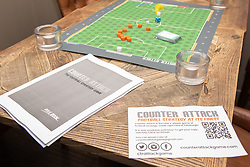 Edinburgh football fan and game designer Colin Webster has designed a brand-new football strategy game called Counter Attack. Last night he hosted a game session in Leith to demonstrate the game to a few interested players. The game is currently on the crowd-funding site Kickstarter and on track to meet it's funding target. If so, Colin hopes the gamne will be available by August this year. Pictured:<br /> <br /> <br /> &copy; Jon Davey/ EEm